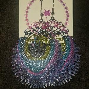 Die cut metal earrings in a peacock design